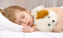 Ребенок скрипит и скрежет зубами во сне: причины и способы лечения