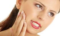 Болит десна: причины и методы лечения