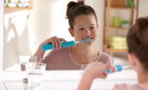Электрическая зубная щетка для детей: типы, плюсы, лучшие модели