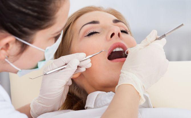Что делать, если опухла десна около зуба